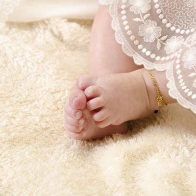 Baby feet or baby with baptism clothes
